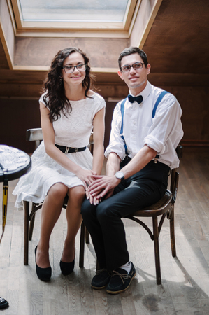 modest: Portrait of young couple in cafe. Posing modest. Stock Photo