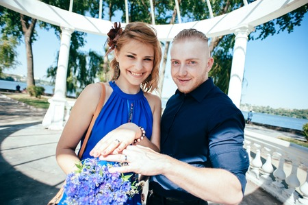 love dome: Newly-married couple show their wedding rings.