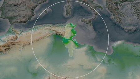 Enlarged area of Tunisia surrounded by a circle on the background of its neighborhood. Color physical map Stock fotó