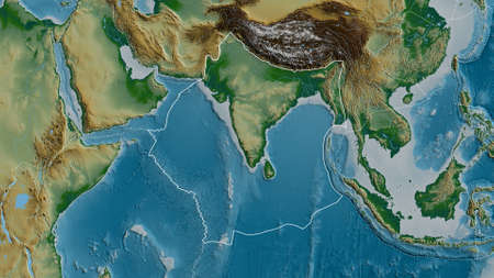Outline of the Indian tectonic plate with the borders of surrounding plates against the background of a physical map. 3D rendering