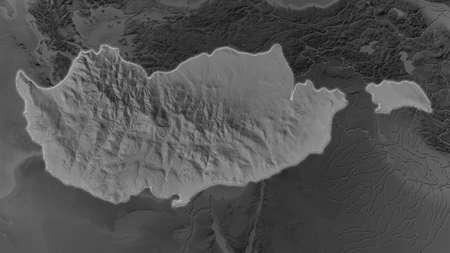 Cyprus area enlarged and glowed on a darkened background of its surroundings. Grayscale bumped elevation map Imagens