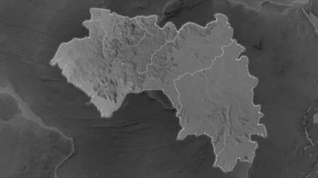 Guinea area enlarged and glowed on a darkened background of its surroundings. Grayscale bumped elevation map