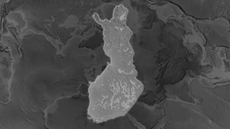 Finland area enlarged and glowed on a darkened background of its surroundings. Grayscale bumped elevation map