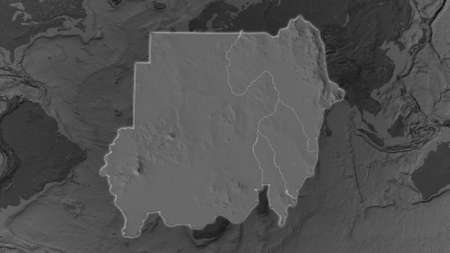 Sudan area enlarged and glowed on a darkened background of its surroundings. Bilevel bumped elevation map Stockfoto