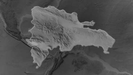 Dominican Republic area enlarged and glowed on a darkened background of its surroundings. Grayscale bumped elevation map
