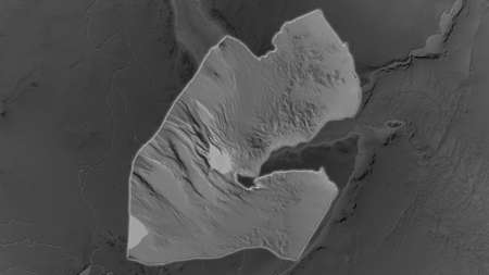 Djibouti area enlarged and glowed on a darkened background of its surroundings. Grayscale bumped elevation map Standard-Bild