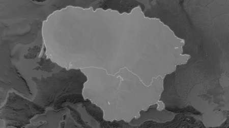 Lithuania area enlarged and glowed on a darkened background of its surroundings. Grayscale bumped elevation map