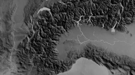Piemonte, region of Italy. Grayscaled map with lakes and rivers. Shape outlined against its country area. 3D rendering