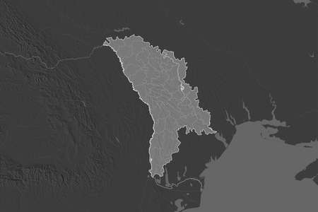 Shape of Moldova separated by the desaturation of neighboring areas. Borders. Bilevel elevation map. 3D rendering Reklamní fotografie