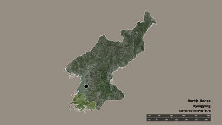 Desaturated shape of North Korea with its capital, main regional division and the separated Hwanghae-namdo area. Labels. Satellite imagery. 3D rendering
