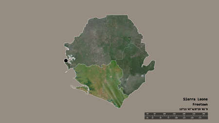 Desaturated shape of Sierra Leone with its capital, main regional division and the separated Southern area. Labels. Satellite imagery. 3D rendering Stok Fotoğraf
