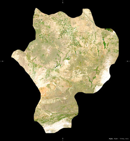 Nigde, province of Turkey. Sentinel-2 satellite imagery. Shape isolated on black. Description, location of the capital. Contains modified Copernicus Sentinel data Stock Photo