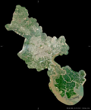Ho Chi Minh, city|municipality|thanh pho of Vietnam. Sentinel-2 satellite imagery. Shape isolated on black. Description, location of the capital. Contains modified Copernicus Sentinel data Archivio Fotografico