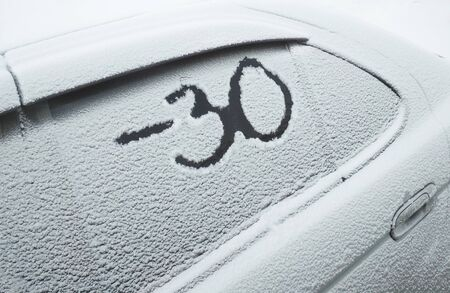 The inscription on a snowy car minus 30 degrees, the concept of harsh winter and frost, weather forecast. Stok Fotoğraf