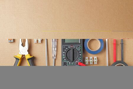 Flat lay, tools and equipment of an electrical engineer or professional worker on a craft background, place for text.