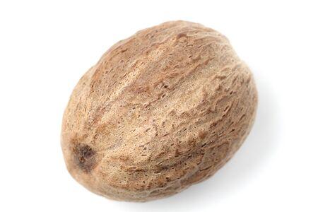 Nutmeg close-up on a white background.