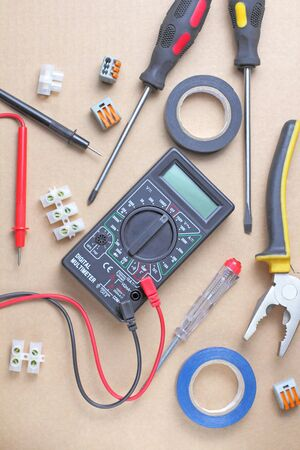 Workspace with electrician tools, craft background, place for text, flat layer, top view.