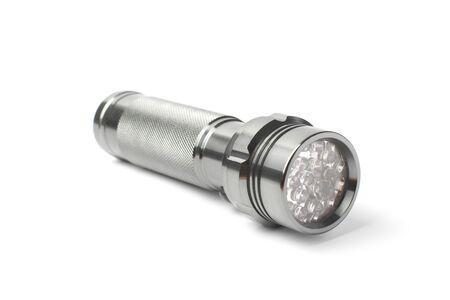 Metal LED flashlight on a white background, isolate.