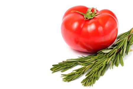 Big red organic tomato and sprigs of fresh rosemary, copy space, close-up, white background, isolate.