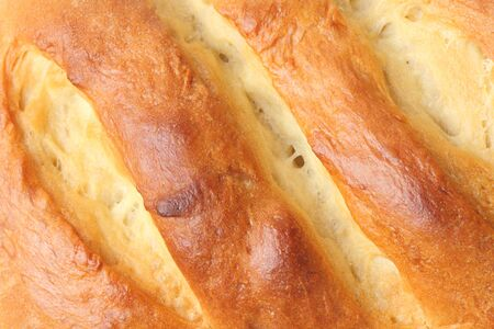 Brown crust of homemade corn bread as a background, close-up. 版權商用圖片