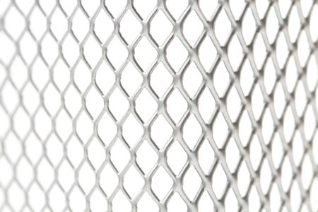 Decorative steel mesh as backdrop or background, close-up, white background.