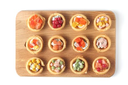 Light snacks, tartlets, tapas, beer or wine or cider, white background. Flat lay, top view, copy space. Stock Photo