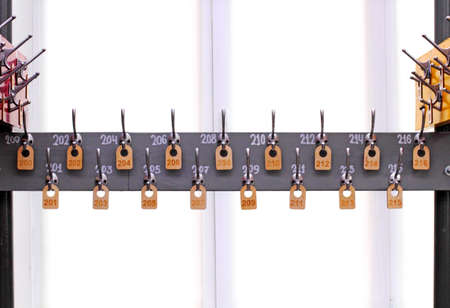 Empty hangers in a school wardrobe waiting for students. School or education theme concept.
