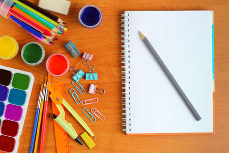 Back to school or education concept. School supplies, gouache, watercolor paints, brushes, sketchbook. Top view, flat lay, copy space, place for text. Stockfoto