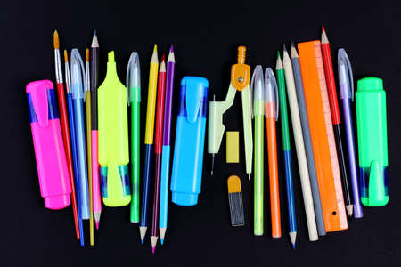 School supplies on black background, pencils, pens, rulers. Back to school or education concept. Top view, flat lay, copy space, place for text. Stockfoto