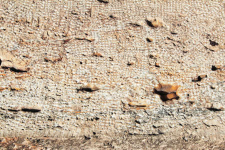 The surface of an antique sandstone wall as a backdrop or backdrop. Stock fotó