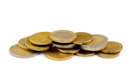 Euro coins on a white background close-up. Money and expenses concept. Place for text, copy space.