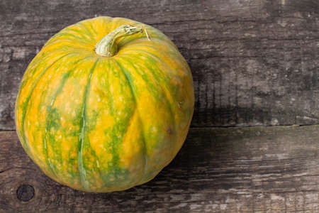 Large pumpkin on a rustic background close-up, place for text. Blank for decoration for Halloween or Thanksgiving. Stock fotó