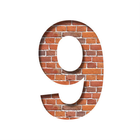 Font on brick texture. Digit nine, 9, cut out of paper on a background of real brick wall. Volumetric white fonts set