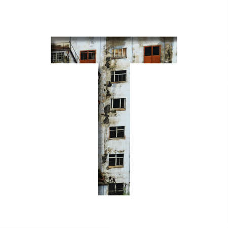 Font on an abandoned industrial building. The letter T cut out of paper on a background of windows and doors of an abandoned industrial building. Set of decorative fonts. Banco de Imagens
