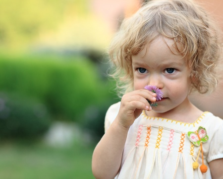 Cute child with flower in spring garden Stock Photo - 8698322