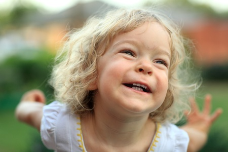Smiling kid in summer park. Shallow depth of field Stock Photo - 8698319