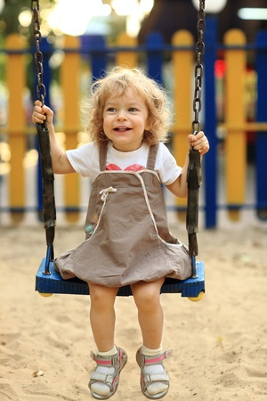 Child on swing in summer park Stock Photo - 8786177