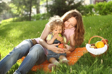 Family having picnic in summer park photo