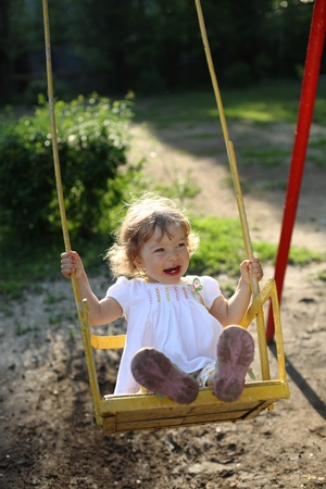 back lighting: Playing on the swings after summer rain - shallow depth of field, back lighting