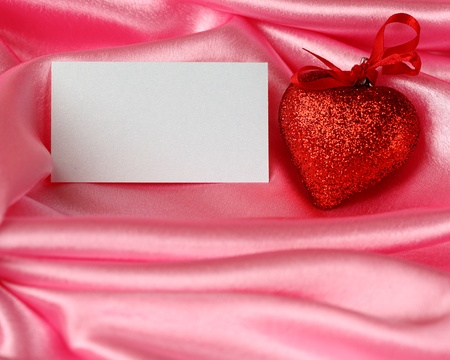 Valentine`s card - hearts and blank on pink satin photo