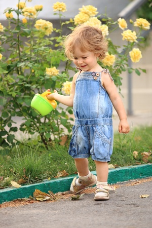 Smiling child in spring garden with roses Stock Photo - 8786153