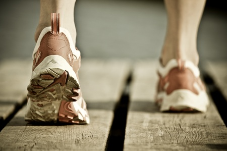 Feet of jogging man. Vintage tinted image Stock Photo - 9059460