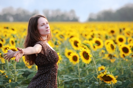 Young woman in sunflower field photo