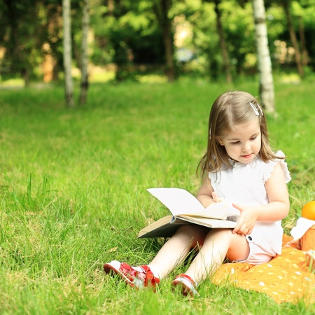 Child having picnic in summer park Stock Photo - 9059467