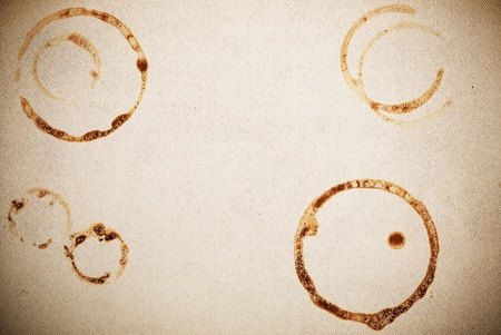 Textured paper with coffee marks photo