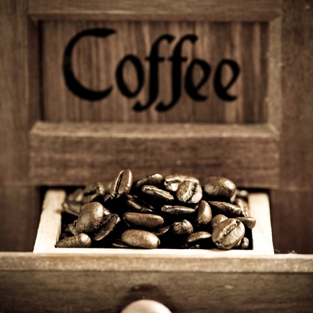 Coffee beans in retro grinder photo