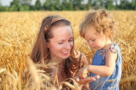 Woman with child in field of wheat photo