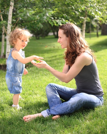 Woman with child having fun in summer park  photo