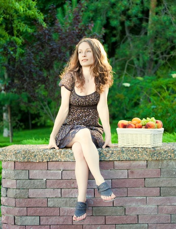 Beautiful woman having picnic in summer park photo