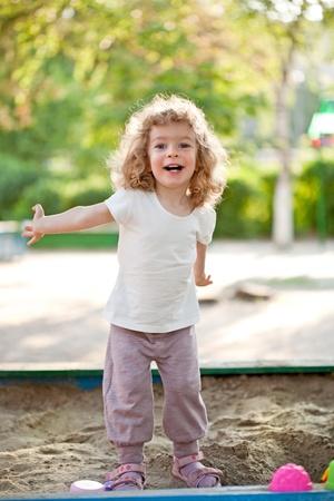 Child on playground in summer park Stock Photo - 9767398